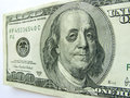 Ben franklin with black eye on one hundred dollar bill this photo illustration of a a might illustrate a tough economy inflation Stock Image
