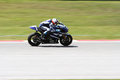 Ben spies of yamaha factory racing team sepang malaysia feb takes a corner at motogp official test sepang on february in sepang Royalty Free Stock Photos
