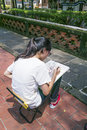 Ben yuan lin's family mansion and garden sight view one girl sits on chair and draws a tree on paper with pencil new taipei city Royalty Free Stock Image
