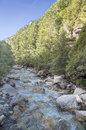 Benasque river surrounded by mountains situated in the spanish province of huesca it s a sunny day in pyrennes mountains it s a Royalty Free Stock Image