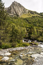 Benasque whitewater river surrounded by mountains situated in the spanish province of huesca it s a cloudy day in pyrennes Stock Photo