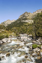 Benasque whitewater river surrounded by mountains situated in the spanish province of huesca it s a sunny day in pyrennes Royalty Free Stock Image