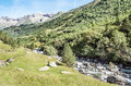 Benasque whitewater river surrounded by mountains situated in the spanish province of huesca it s a sunny day in pyrennes Stock Photos