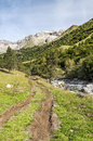 Benasque whitewater river surrounded by mountains situated in the spanish province of huesca it s a sunny day in pyrennes Royalty Free Stock Photos