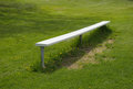 Bench aluminum near a baseball diamond Stock Images