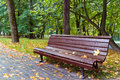 Bench in autumn park Stock Images