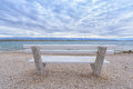 Bench on the beach Royalty Free Stock Photo