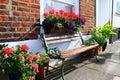 Bench flowers pots sidewalk Royalty Free Stock Photo