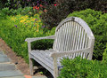 Bench in garden flower on sunny morning Royalty Free Stock Photos