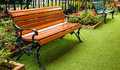 Bench in garden on green grass Royalty Free Stock Photography