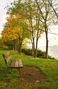 Bench by the lake Royalty Free Stock Photo