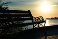 Bench near the sea against beautiful sunset Royalty Free Stock Photography