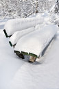 Bench in a park covered completely by snow Royalty Free Stock Photo