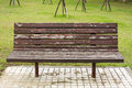 Bench in the park with nobody daytime Stock Photos