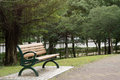 Bench in the park with nobody daytime Royalty Free Stock Photos