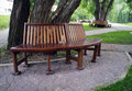 Bench in a park stands by trees Stock Photo