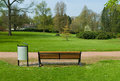 Bench in a park wooden spring time Royalty Free Stock Photo