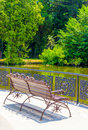 Bench by the pond in park in summer Stock Photography