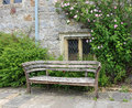 Bench seat in an english garden in early Summer Royalty Free Stock Photo