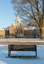 Bench in snow outside Trans-Allegheny Lunatic Asylum Royalty Free Stock Photo