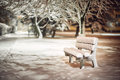 Bench with snow after snowstorm or in snow calamity in europe winter night photograhy in city Royalty Free Stock Images