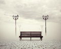 Bench and street lamps view of Royalty Free Stock Photos