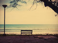 Bench on the summer beach Royalty Free Stock Photo