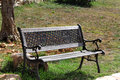 Bench in the sun an empty sunlight a park Royalty Free Stock Images