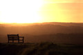 Bench and sundown alone at sunset Royalty Free Stock Photos