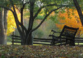 Bench in sunlit countryside Stock Photography