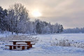 Bench and table in the snow winter wonderland covered forest latvia Stock Photo