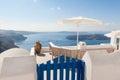 Bench on terrace overlooking Caldera of Santorini Greece Royalty Free Stock Photo