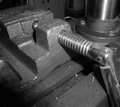 Bench vice this image shows part of a hand on a work placed on top of a drill press Royalty Free Stock Photography