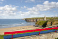Bench view of ballybunion beach cliffs and castle on a cliff edge with views Stock Images