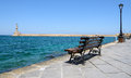 Bench with view on lighthouse of Chania town on Crete island Royalty Free Stock Photo