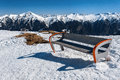 A bench with a view of the snow-capped peaks. Austrian Alps Royalty Free Stock Photo