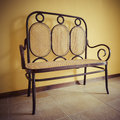 Bench with wickerwork elegant wooden Royalty Free Stock Image