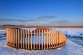 Bench in winter modern the snow covered wetlands a nature area Stock Image