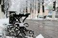 Bench winter sidewalk Royalty Free Stock Photo