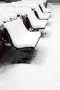 Benches covered with white snow Stock Photo