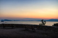 Benches at dusk overlooking the aegean sea in hydra island greece Royalty Free Stock Photography