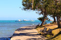 Benches on embankment with view to sea boats yachts in armacao dos buzios near rio de janeiro brazil Stock Image