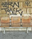 Benches and graffiti in the background Royalty Free Stock Photo