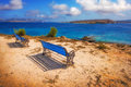 Benches overlooking a beach on Pano Koufonisi island Royalty Free Stock Photo