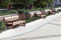 Benches in the park empty wooden on sunny day Stock Photo