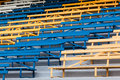 Benches seating steps colors public chairs dozens yellow blue white on for event meetings Royalty Free Stock Photography