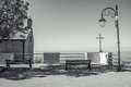 Benches, Simple Church and Cross lookin over Mediteranean Royalty Free Stock Photo