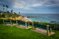 Benches and view of the Pacific Ocean, at Heisler Park, in Lagun Royalty Free Stock Photo