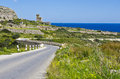 Bendy road castle a narrow leading to a small on the island of malta Royalty Free Stock Image