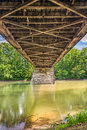 Beneath potters covered bridge the view the wooden potter s spanning the white river near noblesville indiana since shows the Stock Images